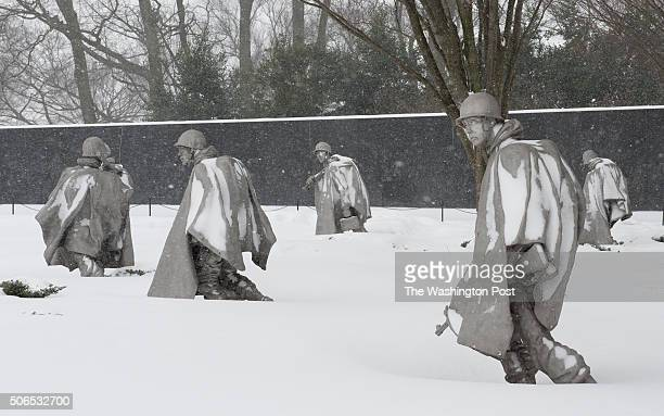 After snow photo of the Korean War Veterans Memorial as snow comes down in Washington DC on January 23 2016 The storm is expected to bring up to two...