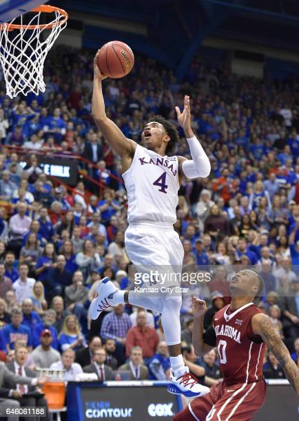 After stealing the ball from Oklahoma guard Darrion StrongMoore right Kansas' Devonte Graham races down the floor for a layup during the first half...
