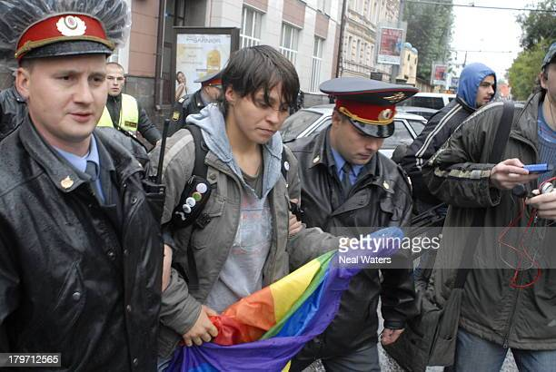 After struggling to remove the rainbow flag from the hands of this gay rights protester at a Moscow demonstration in 2007 the police take the...