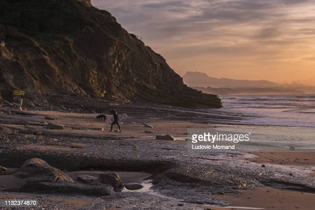 after surf at sunset in the basque country - atlantik stock-fotos und bilder