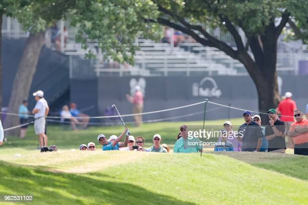 After taking a drop Emiliano Grillo of Argentina hits his approach shot to during the second round of the Fort Worth Invitational on May 25 2018 at...