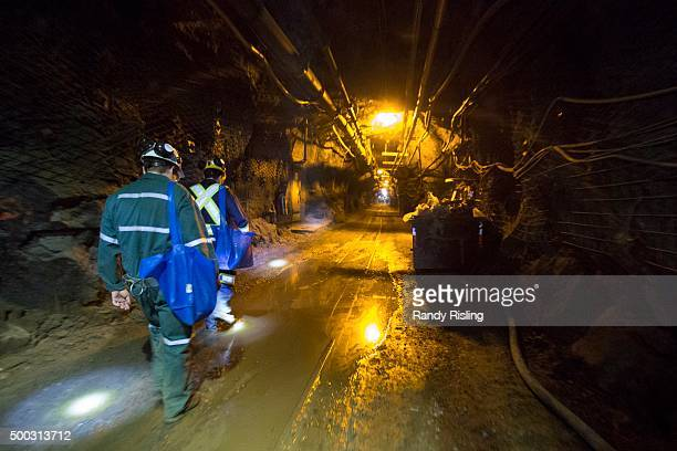After taking an elevator down 2000m SNOLAB employees and visitors walk 14kms through Vale Creighton mine en route to the lab