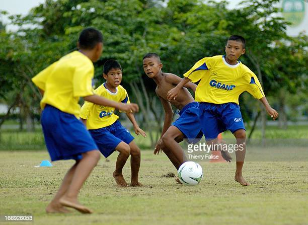 After technical and tactical exercises the daily training session ends with a match here between Thai students and their Ivory Coast counterparts The...