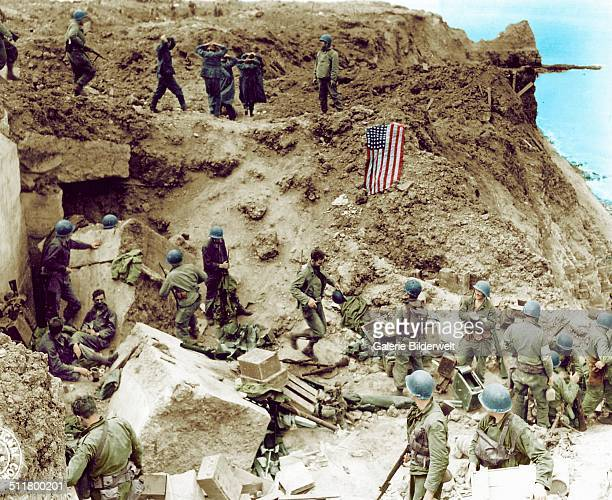 After the assault at the cliffs of Pointe du Hoc by the 2nd Ranger Battalion Colonel James E. Rudder establishes a Post Commando. June 1944. German...
