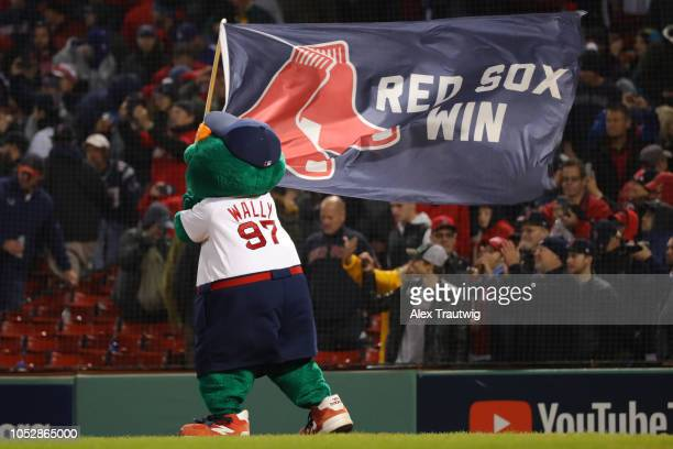 After the Boston Red Sox win Game 1 of the 2018 World Series against the Los Angeles Dodgers their mascot Wally celebrates at Fenway Park on Tuesday...