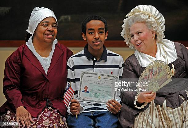 After the Citizenship Ceremony at Mt Vernon Yafiet Gojela 13 from Alexandria poses with Mt Vernon's Denise BraxtonbrownSmith she plays Caroline and...