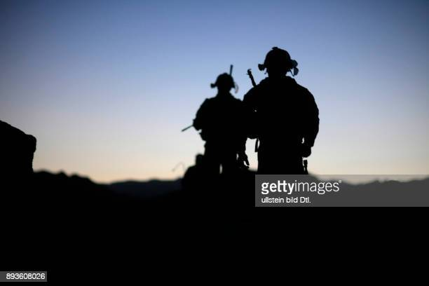 After the discovery of a hidden armory of the taliban the American 101st Airborne Division patrols the mountains during a nightpatrol