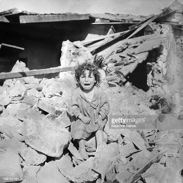 After The Earthquake Which Had Ravaged Orleansville Two Days Earlier A Little Girl Is Crying Among The Ruins Of Her Destroyed Home On September 11Th...