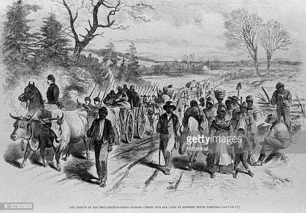 After the Emancipation Proclamation was issued on January 1 freed slaves like this group made their way north crossing the confederate lines at...