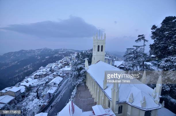 After the fresh snowfall on last night, the view of snow covered roofs of houses in the state capital of Himachal Pradesh, on January 13, 2019 in...