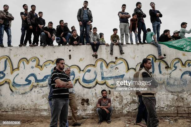 After the funeral, Palestinians gather to mourn in a cemetary close to the tomb of a 23 year old Palestinian who was killed earlier this day by...