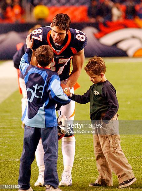 After the game Broncos WR 87 Ed McCaffrey greets his sons Max McCaffrey and Christian McCaffrey on the field Broncos They won 377