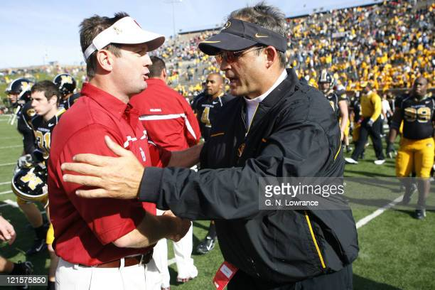 After the game head coaches Bob Stoops and Gary Pinkel meet on the field following a 26-10 Oklahoma win over the Missouri Tigers at Faurot Field in...