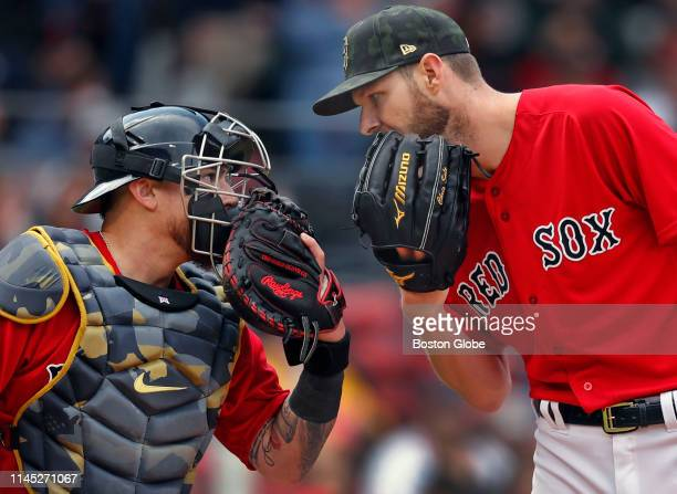After the Houston Astros' Robinson Chirinos scored on a second inning wild pitch Red Sox catcher Christian Vazquez left and starting pitcher Chris...