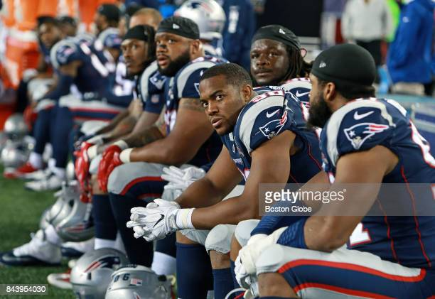 After the Kansas City Chiefs scored their 41st point of the game dejected New England Patriots defenders are pictured on the bench The New England...