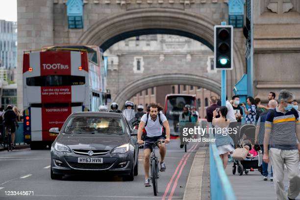After the lifting of both bascules that allowed a tall boat boat to pass underneath, cyclists and traffic cross during the evening rush-hour, on 11th...