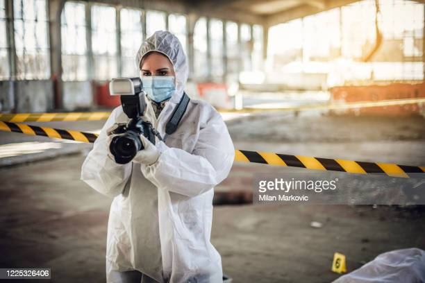 after the murder, criminal inspectors work at the crime scene - crime scene stock pictures, royalty-free photos & images