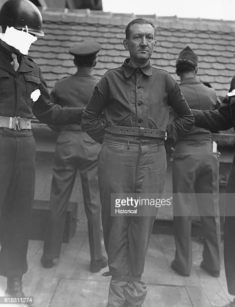 After the Nuremberg war crimes trials convicted Nazi war criminal Karl Gronwaldt stands on the gallows about to be hanged ca 1946 The photo has been...