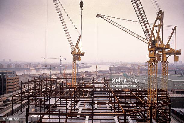 After the old Canary Wharf was demolished cranes can be seen across the Docklands in its process of redevelopment seen in the foreground the building...