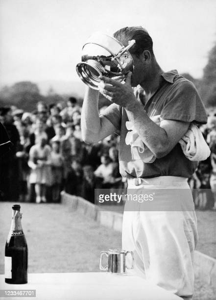 After the polo match he won with his team at Cowdray Park, West Sussex, the Duke of Edinburgh drinks Doulet champagne in the Holden White Cup he just...
