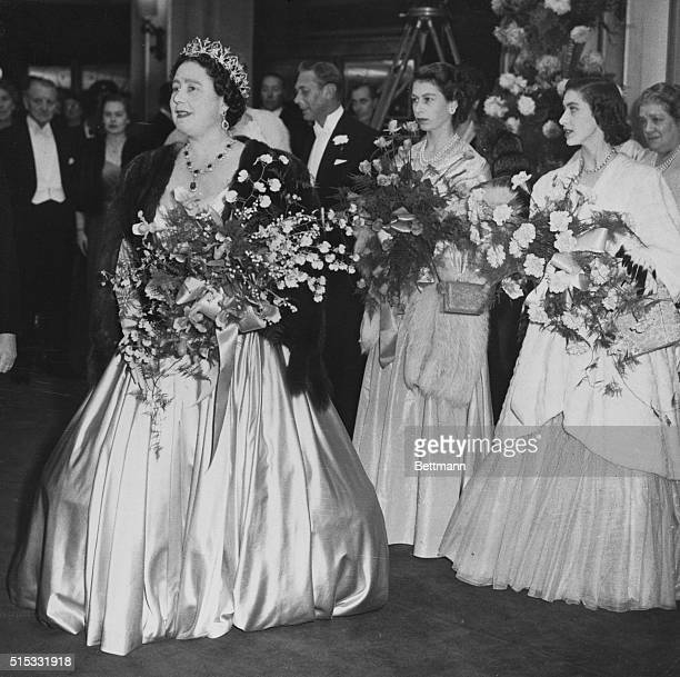 After the presentation of bouquets the Royal Family of Great Britain move into the Odeon Theater in London to see the Royal Command showing of the...