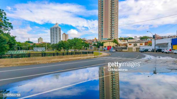 after the rain the reflection reveals the beauty of the city. - crmacedonio stock pictures, royalty-free photos & images