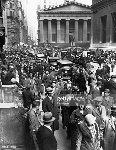 After the stock market plummeted 400 extra police were dispatched to protect the financial district Here crowds of worried pedestrians walk on Wall...