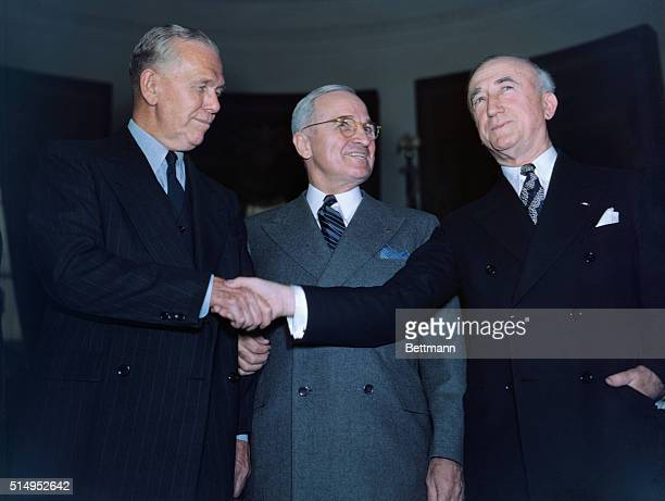 After the swearing in ceremonies, here is George C. Marshall, the new Secretary of State, President Harry S. Truman, and outgoing Secretary of State,...