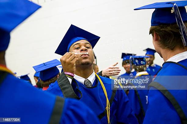 After the very first graduation of Tuscarora High School seniors Alden Carpenter celebrates by blowing bubbles after picking up his diploma Tuesday...