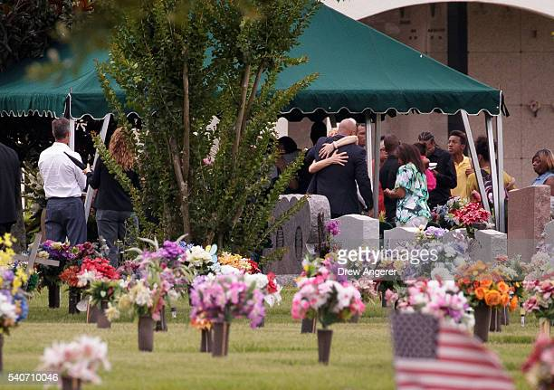 After the viewing and funeral service, mourners gather at the burial site for Kimberly Morris, June 16, 2016 in Kissimmee, Florida. Morris, who...