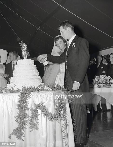 After their colorful wedding ceremony at StMary's Roman Catholic Church Robert FKennedy and brideformer Ethel Skakelare shown cutting their wedding...
