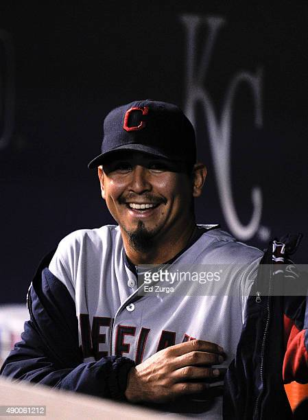 After throwing a complete game shutout against the Kansas City Royals Carlos Carrasco of the Cleveland Indians smiles as he puts on his jacket at...