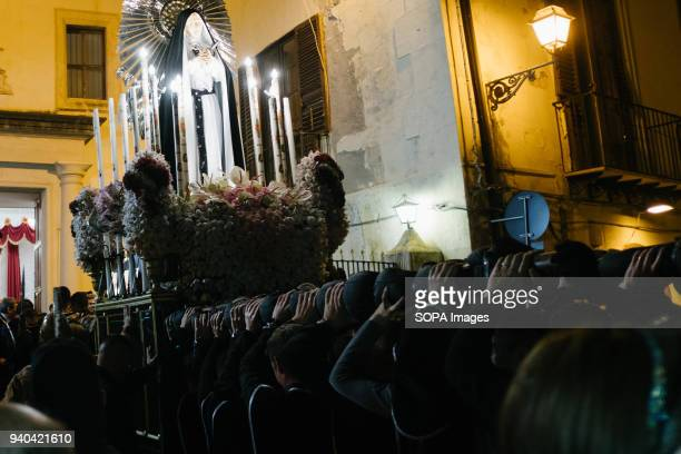 After travelling though the streets of the neighbourhood for hours the statue of the Holy Mary re enter the church of cocchieri On the holy Friday...