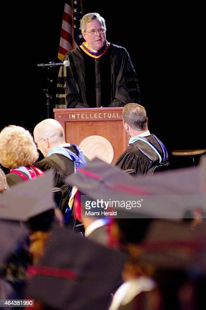 After turning the podium towards the graduates former Governor of Florida Jeb Bush gives the Commencement Address to the graduating class during the...