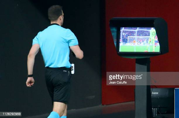 After using the Video Assistance referee Felix Zwayer of Germany cancels the goal for Atletico Madrid during the UEFA Champions League Round of 16...
