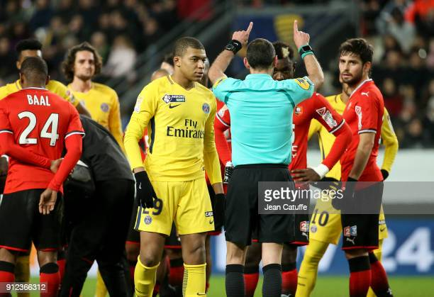 After viewing the video referee Mikael Lesage gives a red card to Kylian Mbappe of PSG during the French League Cup match between Stade Rennais and...