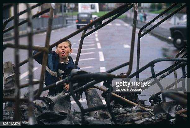 After violence that followed a Catholic demonstration to protest against the British occupation of Northern Ireland in Belfast a child plays among...