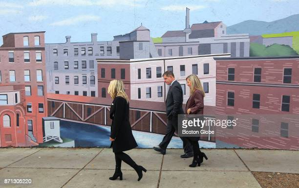After voting at the Lower Mills Branch of the Boston Public Library Mayor Martin J Walsh heads up Richmond Street with his partner Lorrie Higgins...