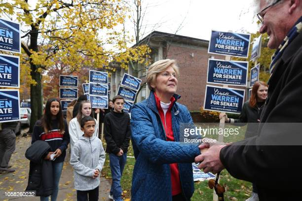 After voting US Senator Elizabeth Warren greets supporters outside the Graham Parks School in Cambridge MA on Election Day Nov 6 2018 Behind her are...
