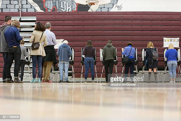 After waiting in line for 15 hours morning voters cast their ballots on election day November 8 2016 at Grady High School in Atlanta Georgia After a...