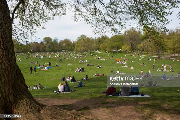 After weeks of rain and self-isolation during the COVID-19 pandemic, New Yorkers come outside and attempt to practice social distancing on a warm...