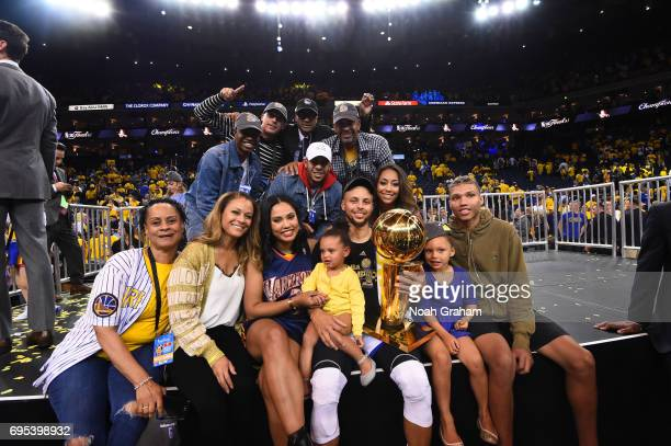 Stephen Curry of the Golden State Warriors with family and friends celebrates winning the NBA Championship in Game Five against the Cleveland...