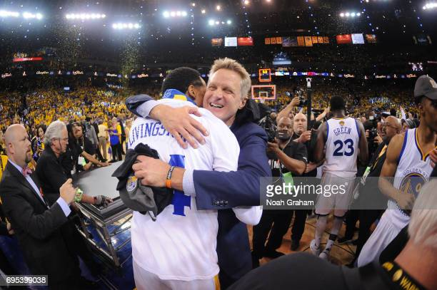 Head Coach Steve Kerr embraces Shaun Livingston of the Golden State Warriors and celebrate winning the NBA Championship in Game Five against the...