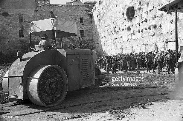 After winning the SixDay War and capturing the Old City of Jerusalem Israelis bulldozed the houses in front of the Western Wall to form a gather...