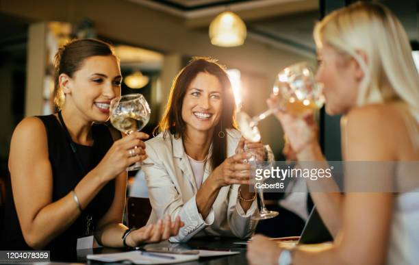 after work drink - mid adult women stock pictures, royalty-free photos & images