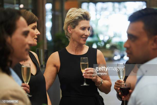 after work drinks with business coworkers. - stereotypically upper class stock pictures, royalty-free photos & images