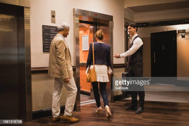 after you - doorman stock photos and pictures