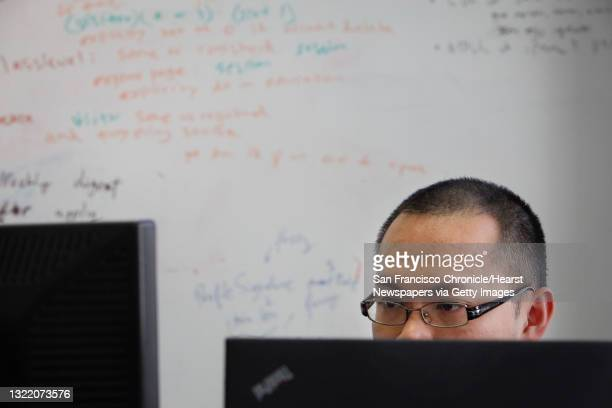 AfterCollege software/web developer Perry Lee works in front of a white board used for brainstorming at the AfterCollege headquarters on Thursday,...
