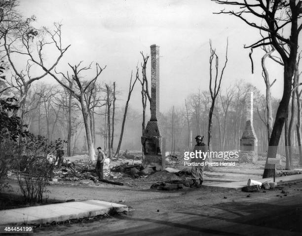 Aftermath of 1947 fire Private James Gorman a National Guardsman stands watch against looting at the ruins of a house in Kennebunkport's Goose Rocks...