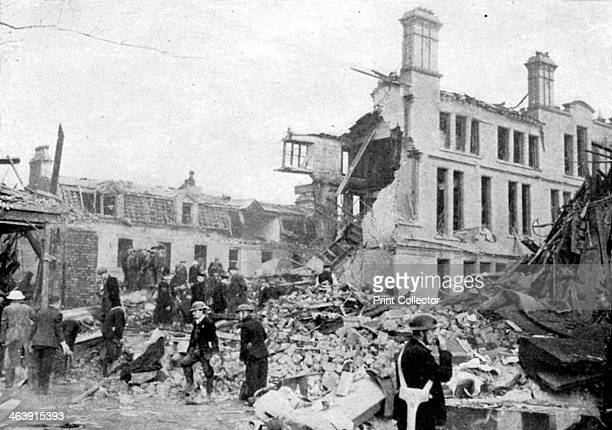 Aftermath of a German bombing raid Merseyside World War II March 1941 Rescue workers searching for survivors in the wreckage of buildings after a...